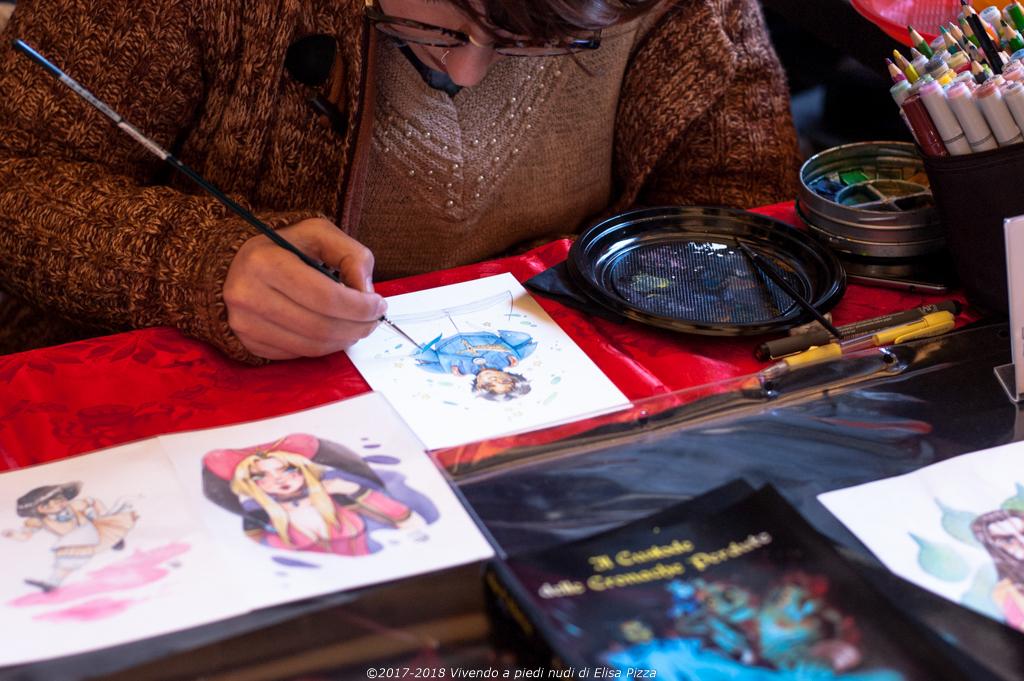 artista dipinge personaggi fumetto